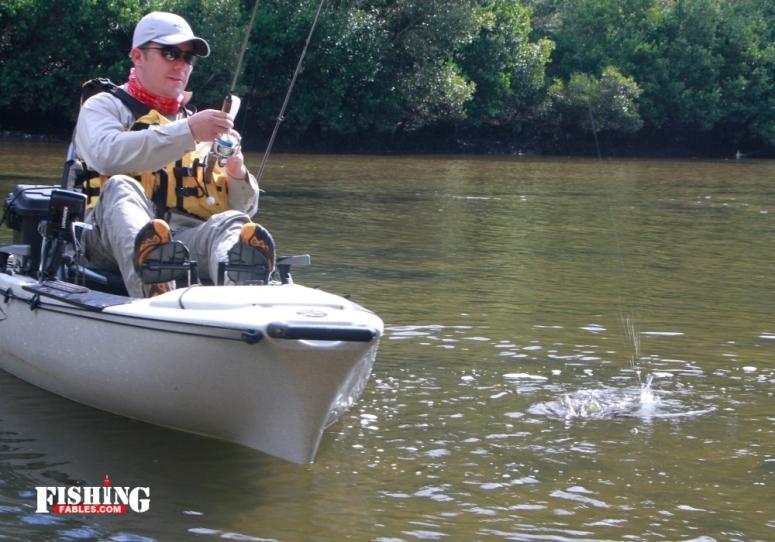 Greg plays a fish to the kayak